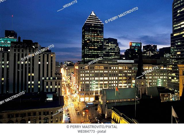 Downtown Montreal skyline with view of Sainte-Catherine street at dusk, Quebec, Canada