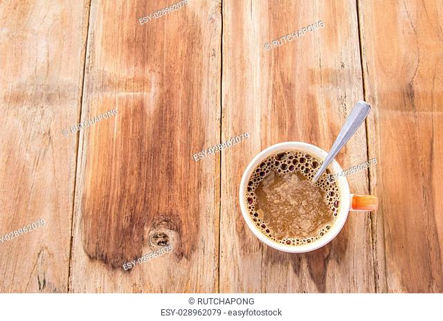 Cup of coffee on a old wooden table. top view