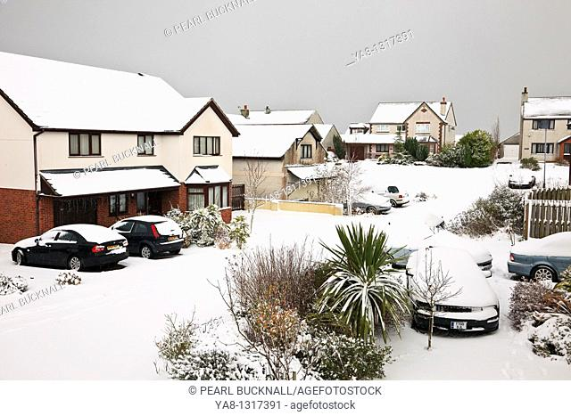 Benllech, Anglesey, North Wales, UK, Europe  Snow on suburban estate street and houses during heavy winter snowfall
