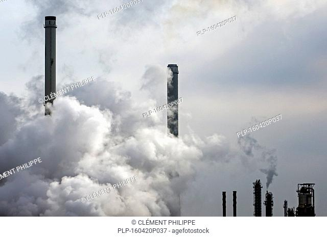 Conceptual image showing air pollution from petrochemical industry showing chimneys encompassed with smoke