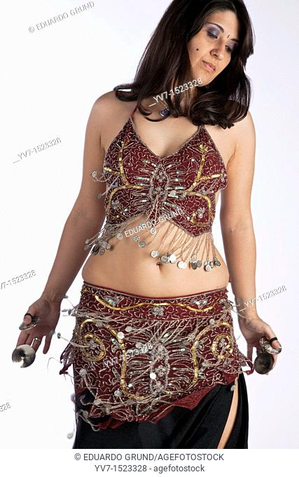 Beautiful brunette practicing belly dancing
