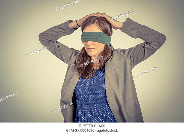 Blindfolded young woman