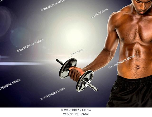 Fit man lifting dumbbell standing against digitally generated background