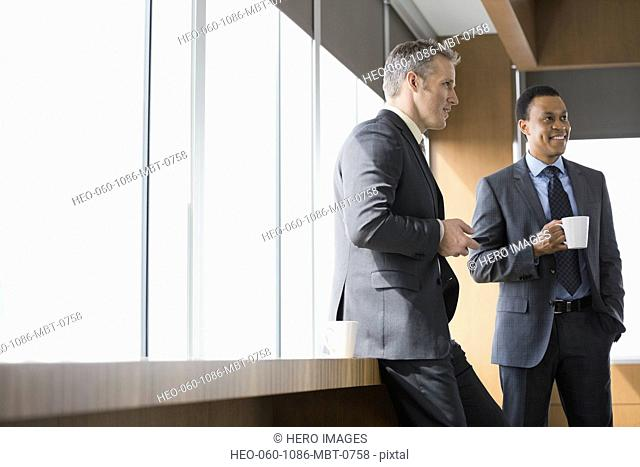 Businessmen talking in conference room