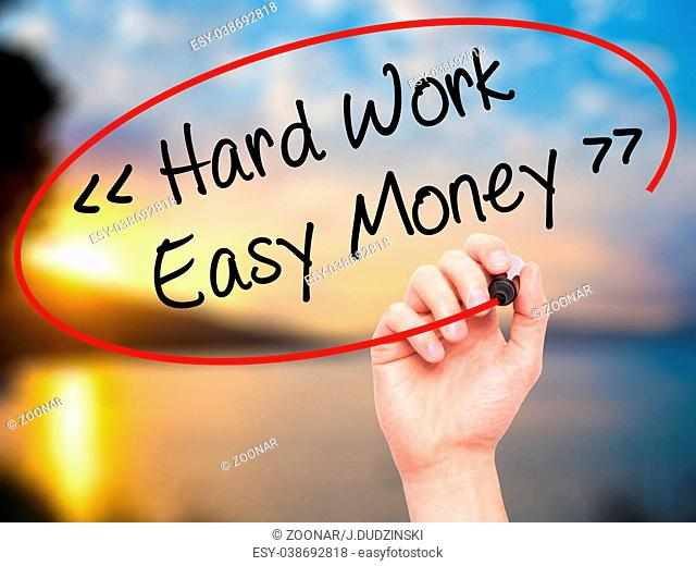 Man Hand writing Hard Work - Easy Money with black marker on visual screen