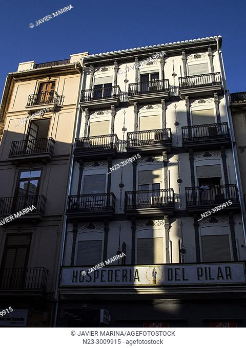 Shadows of buildings projected on the El Pilar inn, Valencia, Spain