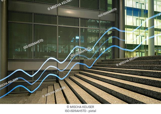 Illuminated wavy lines moving up office building steps