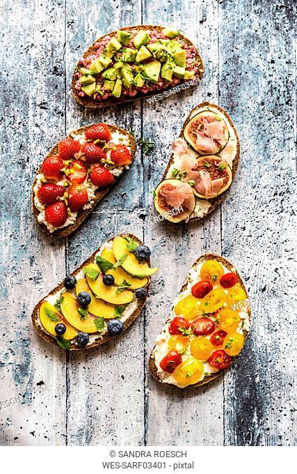Different sandwiches, strawberry, fig, nectarine, avocado, tomato