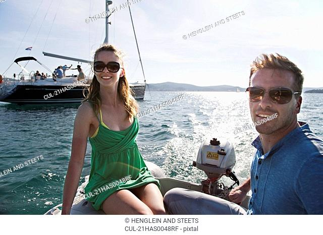 Man and woman in yacht dinghy