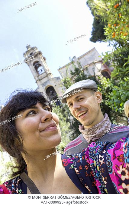 Young couple of tourists discovering urban gardens. Palermo, Sicily. Italy
