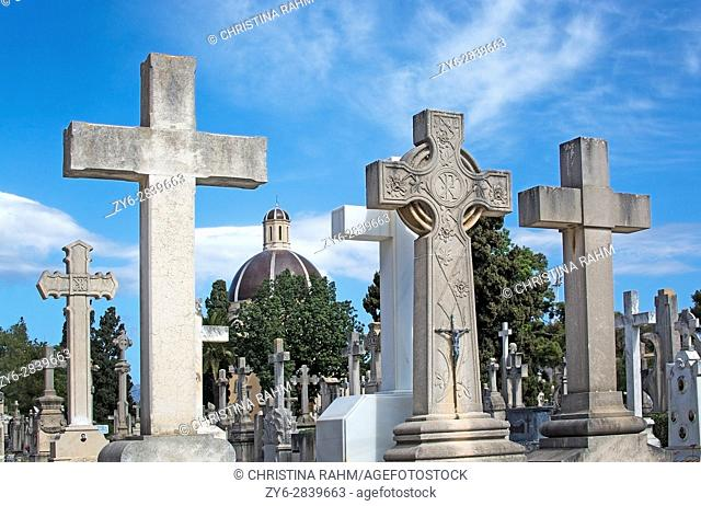 PALMA DE MALLORCA, SPAIN - MARCH 23, 2017: Tanatori son Valenti Palma cemetery tombstone crosses and church cupola on March 23, 2017 in Palma, Mallorca, Spain