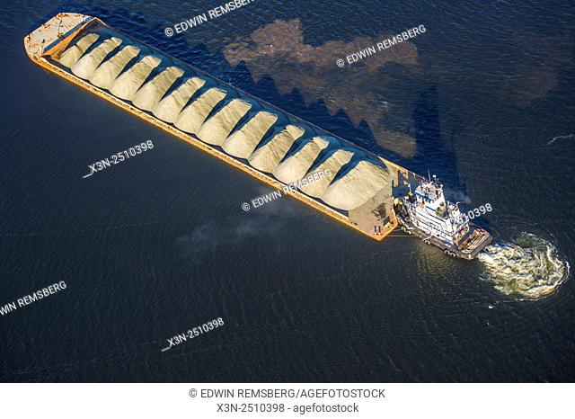 Aerial view of a tug boat pushing a barge in Harford County, Maryland