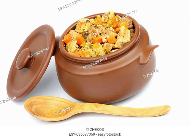 Beef Stew and Vegetables in Pot with Lid and Wooden Spoon isolated on white background
