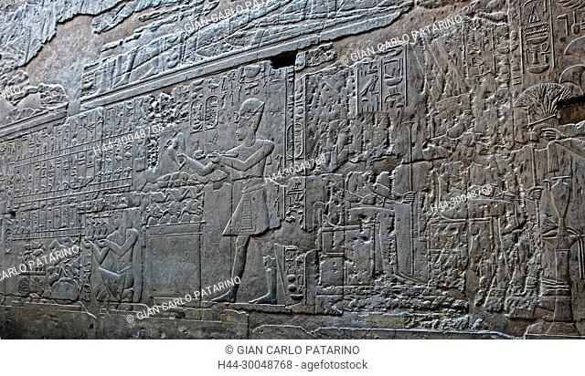 Luxor, Egypt. Temple of Luxor (Ipet resyt): the pharaoh Nebmaatra Amenhotep III offering to gods