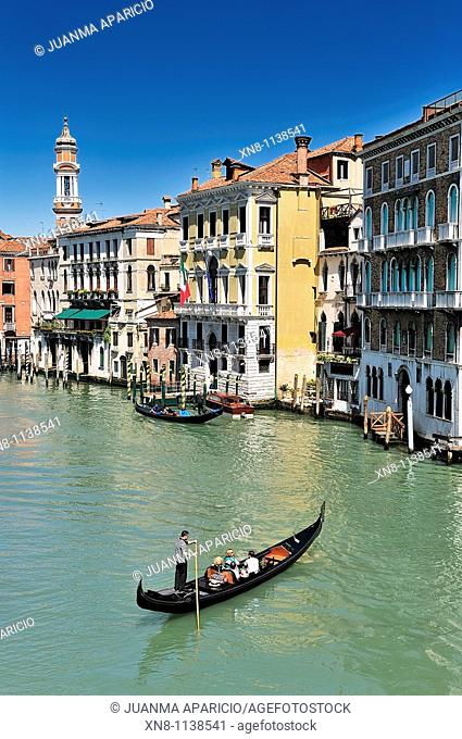Gondola with tourists crossing the Grand Canal, Venice, Italy