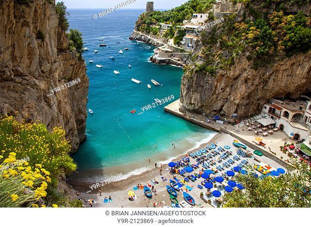 Tiny beach in the rocky coastline of Amalfi near Praiano, Campania Italy