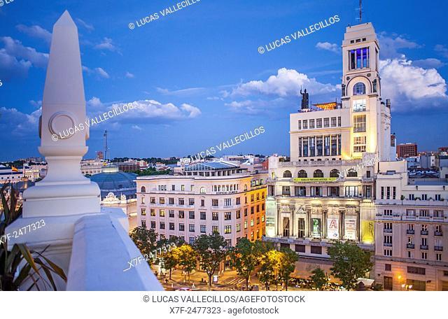 At right Circulo de Bellas artes cultural center building, in Calle Alcala, Madrid, Spain