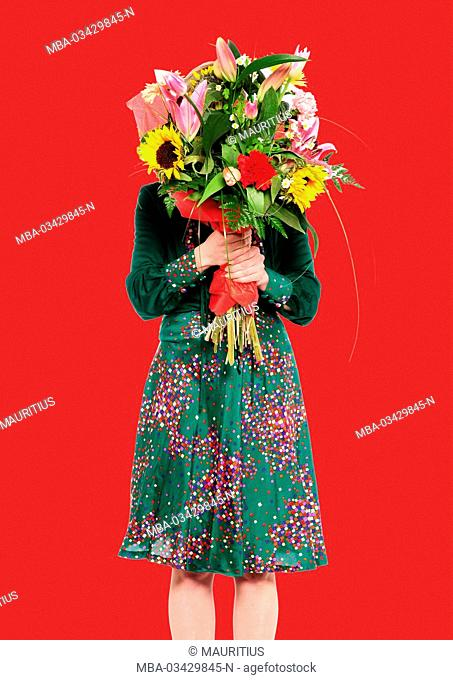 Woman with bouquet in front of her face
