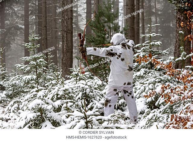 France, Bas Rhin, Hunting Bow Archery in winter in winter dress