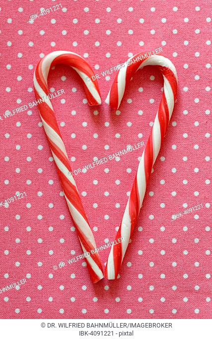Red and white candy canes forming heart shape