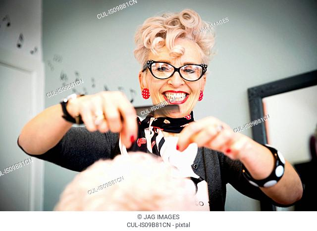 Woman working in hair salon