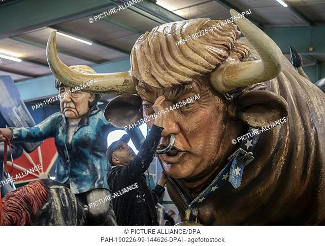 26 February 2019, Rhineland-Palatinate, Mainz: US President Donald Trump is shown as an ox with horns and a ring through his nose at the presentation of the...