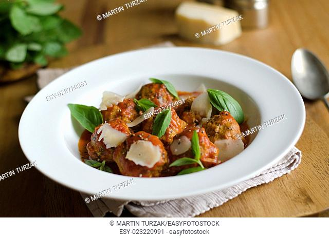 Pork meatballs in tomato sauce with garlic and basil