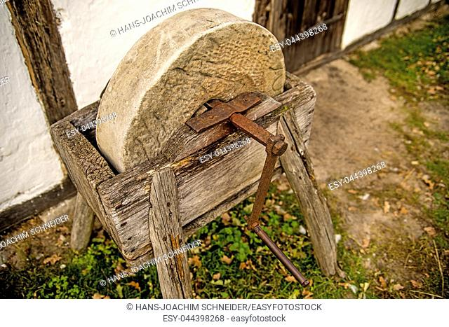 old rotary grindstone at a country house