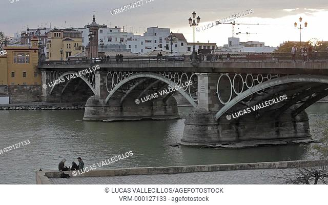 Isabel II bridge or Triana bridge. Guadalquivir river. Seville, Andalusia, Spain