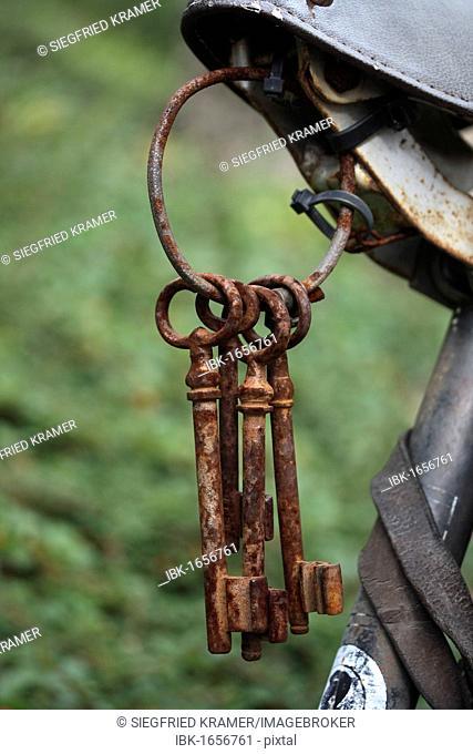 Old rusty keys on a key ring