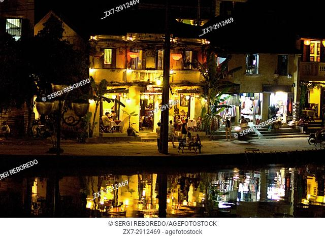 Hoi Riverside at Night. Old Town Hoi An at Night. Hoi An. Hoi An old quarter. View across Thu Bon river onto the beautiful Bach Dang river promenade with it's