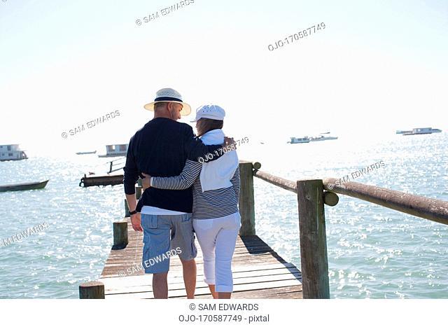 Mature couple walking on pier
