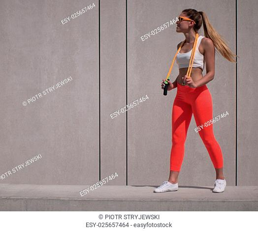 Full Length Shot of a Fit Young Woman Holding a Jumping Rope Over her Shoulders with Copy Space on the Left Side of the Frame