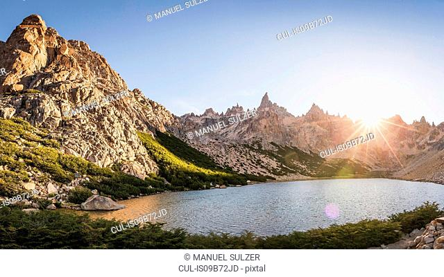 Sunlit landscape view of mountains and Tonchek lake, Nahuel Huapi National Park, Rio Negro, Argentina