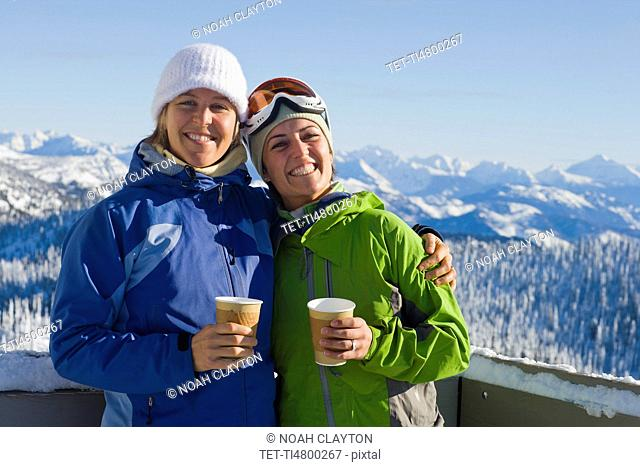 USA, Montana, Whitefish, Portrait of two women with mountains as backdrop