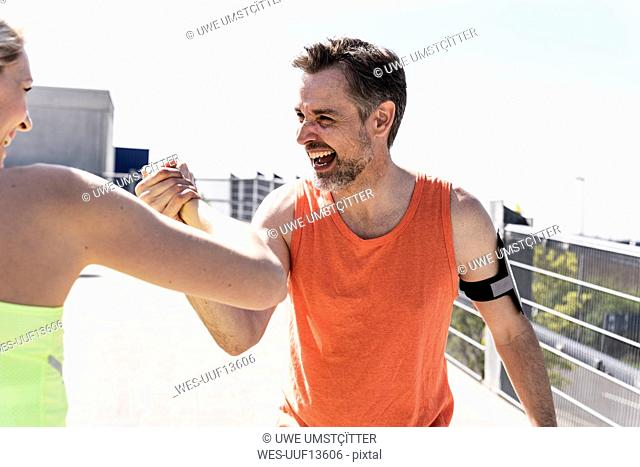Couple working out together, having fun
