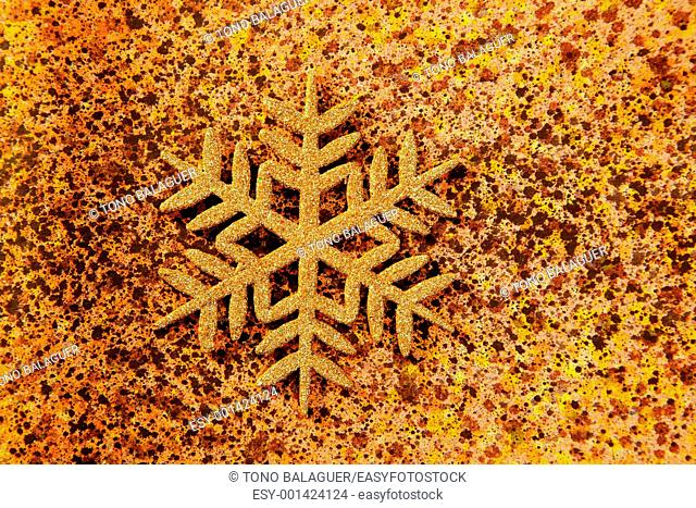 christmas snowflake golden symbol on colorful papel