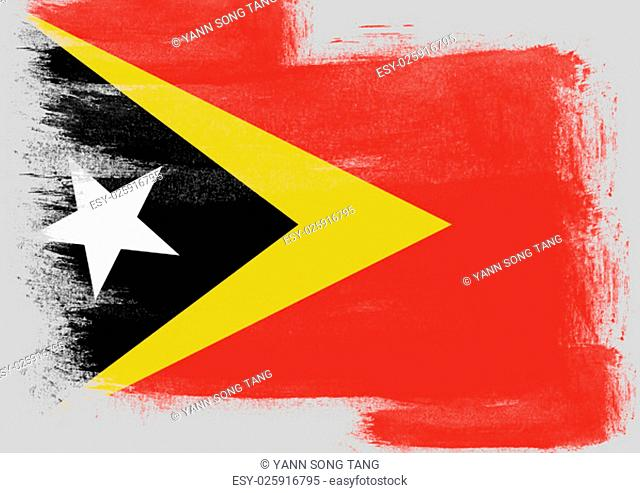 Flag of East Timor painted with brush on solid background