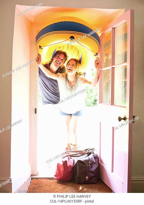 Man and woman under dinghy doorway