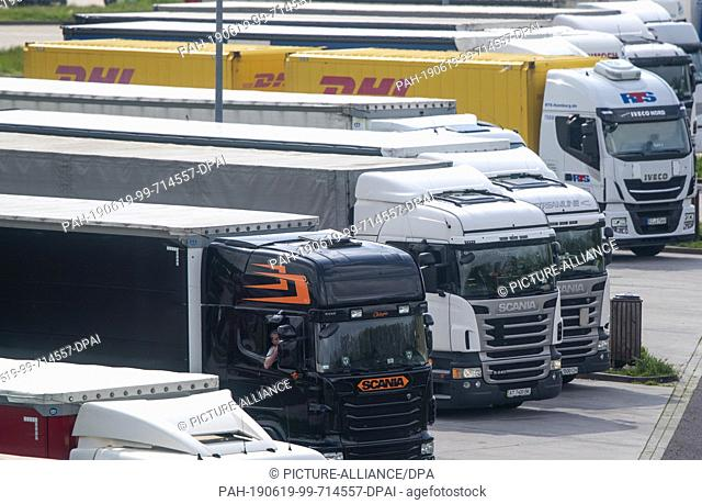 31 May 2019, Saxony-Anhalt, Marienborn: Trucks are parked on the parking lot of the service area next to the memorial of the German division Marienborn