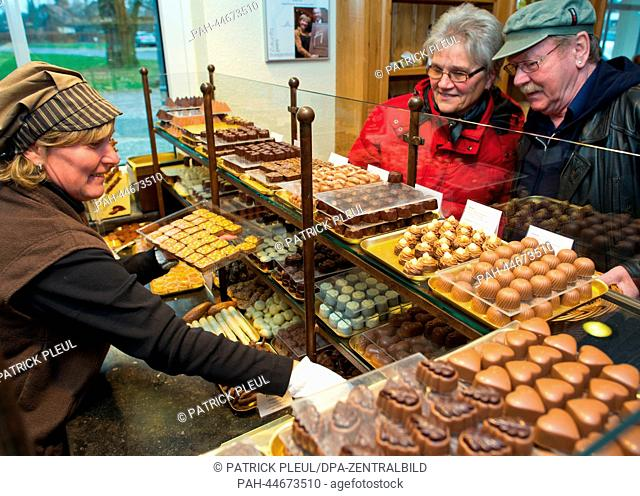 Visitors of the Confiserie Felicitas GmbH look at chocolates chocolates in Hornow, Germany, 02 December 2013. On the same day the first stone was layed for an...