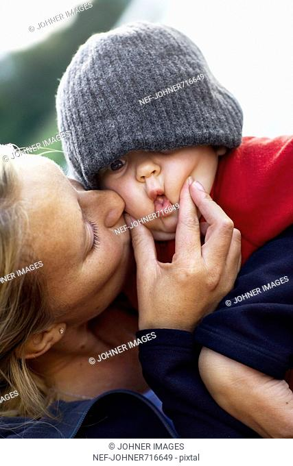A baby girl in the arms of her mother, Sweden