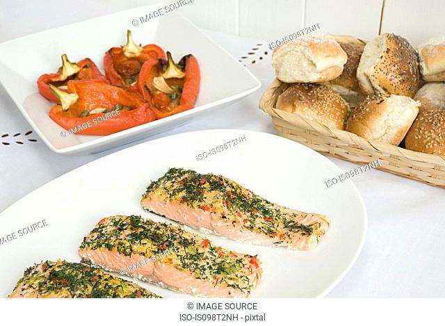 Poached salmon with roasted peppers and bread rolls