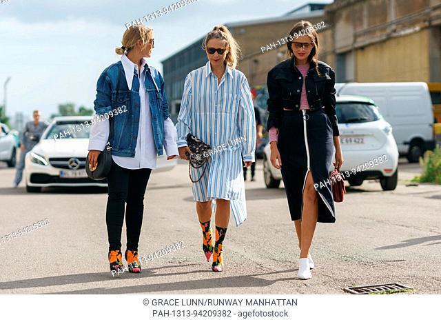 Blogger Janka Polliani, blogger and stylist Line Langmo, and editor Darja Barannik posing outside the Ganni runway show during Copenhagen Fashion Week - Aug 10