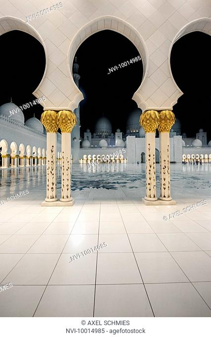 Illuminated colonnades, night, Sheikh Zayed Mosque, Abu Dhabi, UAE