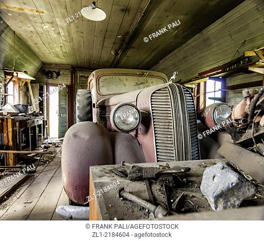 Old garage with Dodge ram truck. The years of dust collecting on the vechicle is visible