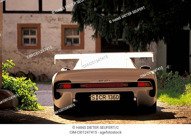 Car, Porsche GT 1, model year 1997, white, roadster, coupe/Coupe, standing, upholding, rear view