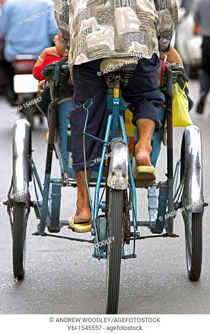 Rear view of cyclo rickshaw and driver Ho Chi Minh City Vietnam