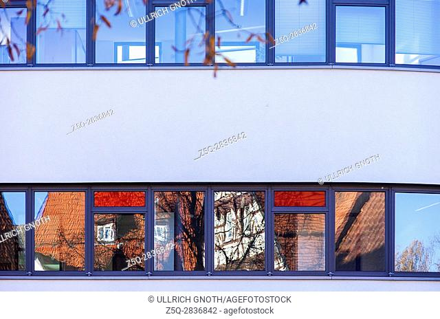 Textures of the city - Reflections of old historic buildings in the windows of a modern architecture, Münsingen, Germany