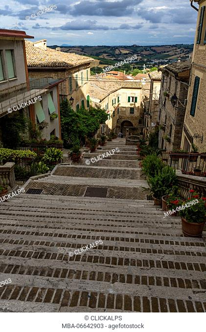 A typical flight of steps among the houses of the old town of Corinaldo Province of Ancona Marche Italy Europe